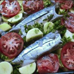 Oven-baked fish with vegetables and potatoes