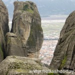 The town of Kalambaka as seen through Meteora giant rocks, close view