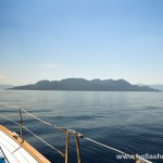 Sailing past Methana